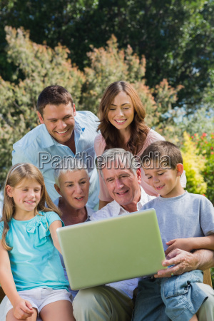 multi generation family with a laptop