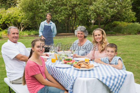 happy extended family having a barbecue