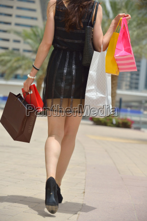 beautiful woman goes in shopping