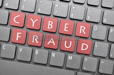 cyber fraud on keyboard