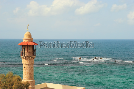 old mosques minaret and beautiful mediterranean