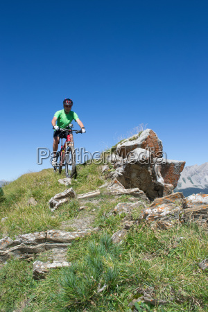 mountain biker riding downhill in swiss