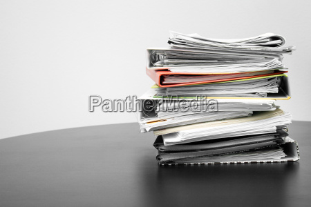 stack of folders and documents on