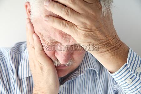 mature man has severe headache