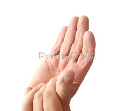 older man has sore thumb