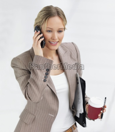 young beautiful smiling business woman talking