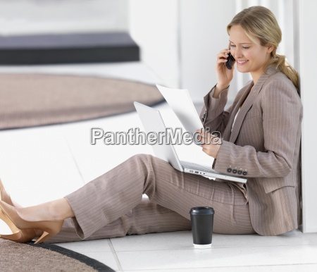 young beautiful business woman using cell