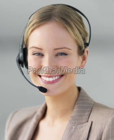 young business woman using head phone