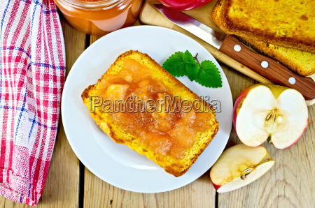 bread with apple jam in plate