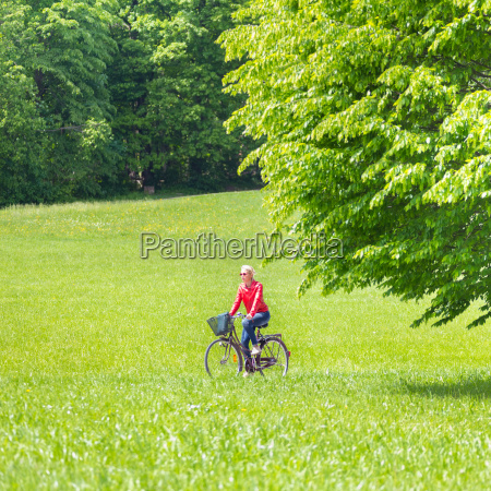 young woman riding a bicycle
