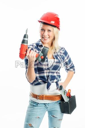 weiblicher handwerker mit akkuschrauber und bohrmaschine