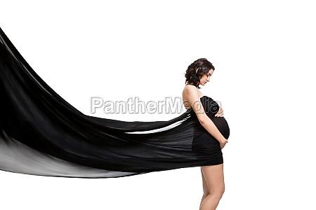 junge attraktive schwangere frau eingewickelt in