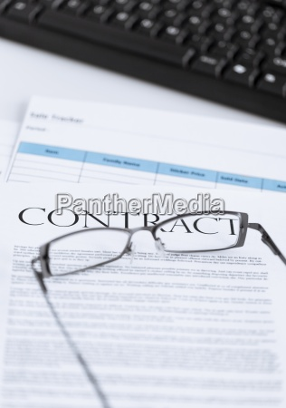 signed contract paper with glasses