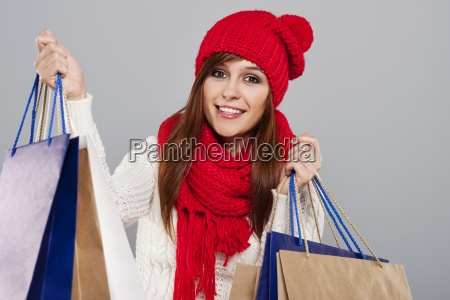 cheerful shopacholic during the winter sale