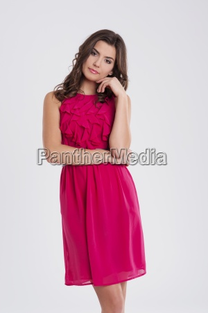 young beautiful brunette in a pink