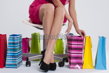 sitting woman checks her shopping