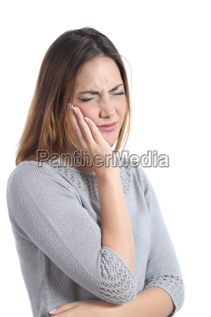 woman suffering toothache with hand on