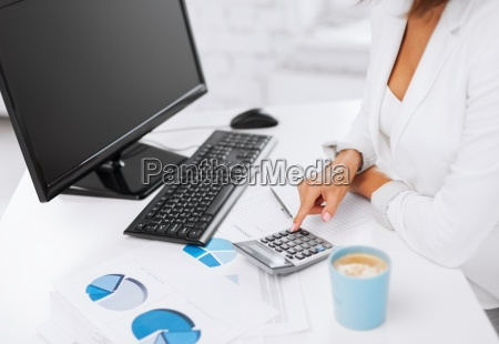 woman hand with calculator and papers