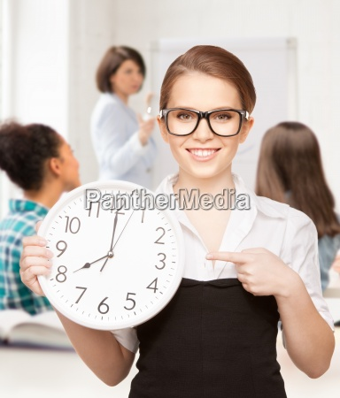 attractive student pointing at clock
