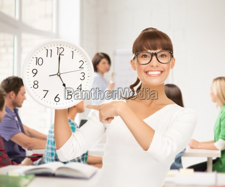 student showing clock