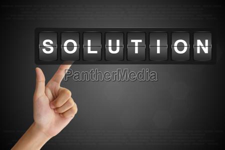 hand pushing solution on flip board