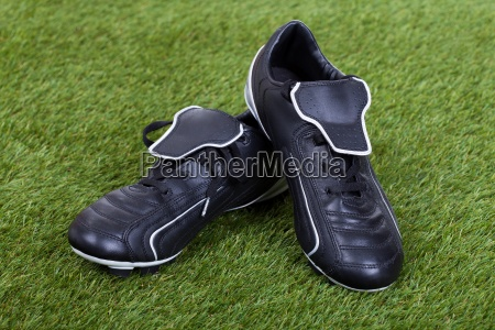 soccer shoes on grass field