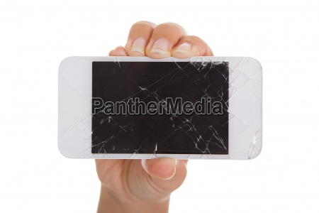 hand holding smartphone with cracked screen