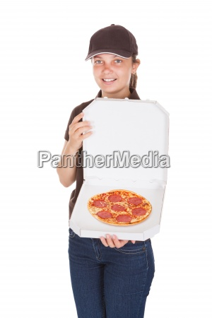 delivery woman holding pizza