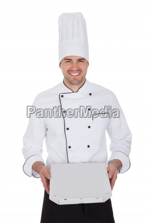 portrait of happy chef holding pizza