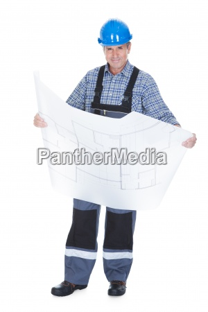 male architect holding blueprint