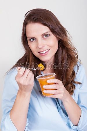 woman enjoying a fresh fruit desert