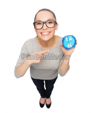 woman in eyeglasses pointing finger to