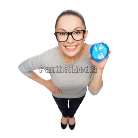 smiling woman in eyeglasses with blue