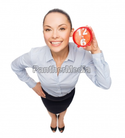 smiling businesswoman with red clock