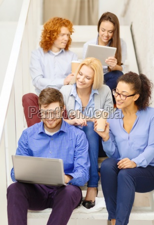 team with laptop and tablet pc