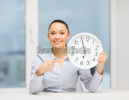 attractive businesswoman with white clock