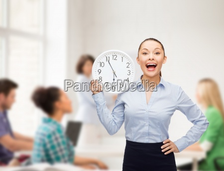 attractive teacher with wall clock