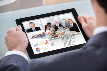 businessman video conferencing with co worker