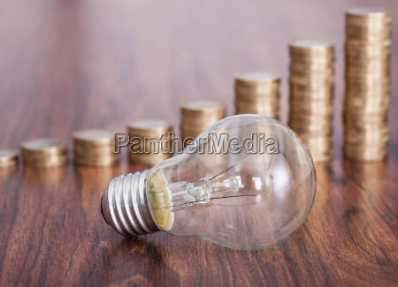 bulb with stack of coins