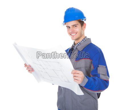 architect holding blueprint