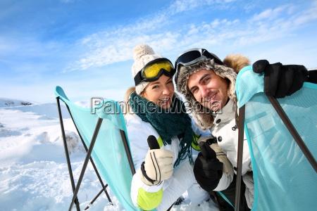 portrait of skiers sitting in long