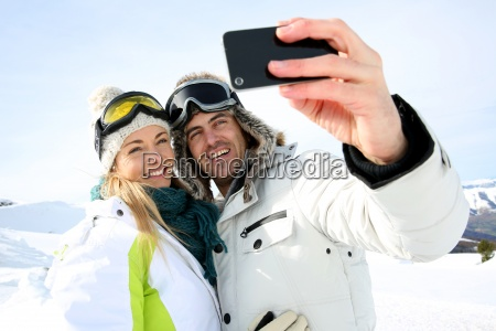 skiers taking picture of themselves with