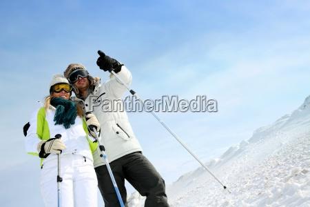 coupl eof skiers on ski run