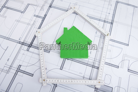 house in folding ruler on blueprint