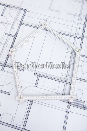 folding ruler in house shape on