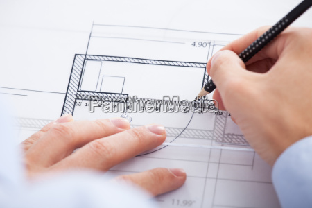 architects hands using pencil and ruler