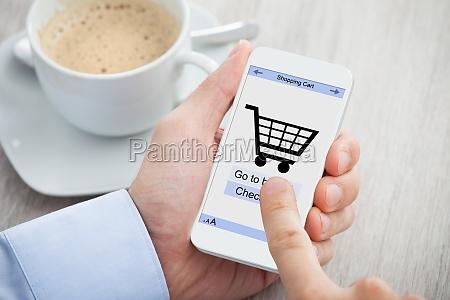 businessmans hands shopping online through smartphone