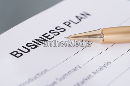 business plan and pen