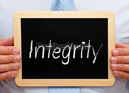 integrity businessman with chalkboard