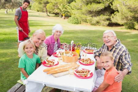 portrait of happy family at picnic
